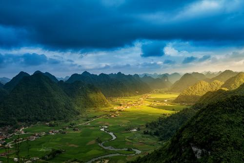 Rice field in valley around with mountain panorama view in Bac S