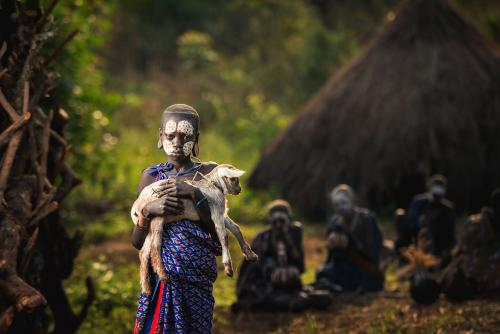 KIBISH, ETHIOPIA - January 14, 2020: The boy Surmi tribe hold go